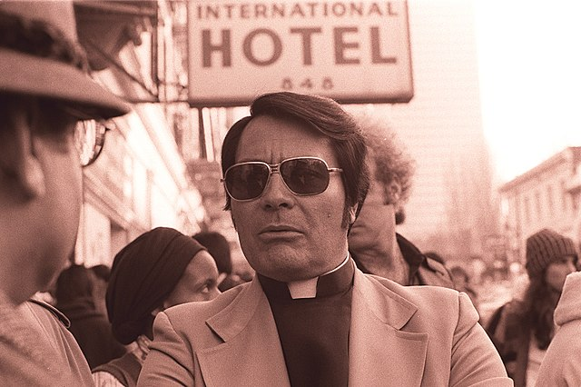 640px-Jim_Jones_in_front_of_the_International_Hotel